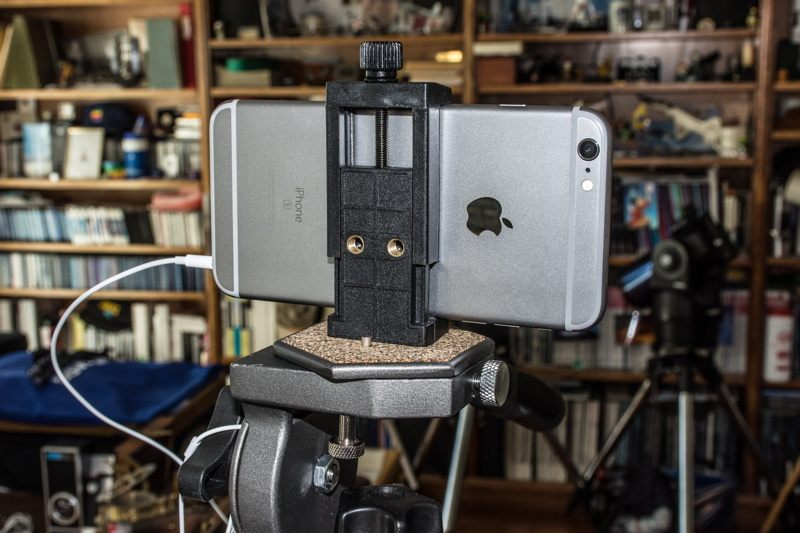 Levenhuk A10 Smartphone Adapter mounted on a camera tripod